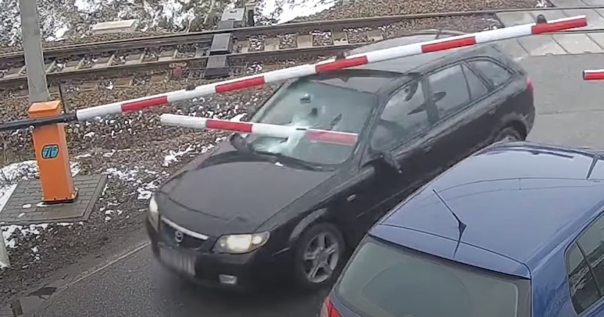 Driver Nearly Gets A Faceful Of Barrier While Fleeing Police